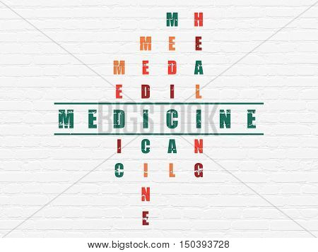 Healthcare concept: Painted green word Medicine in solving Crossword Puzzle