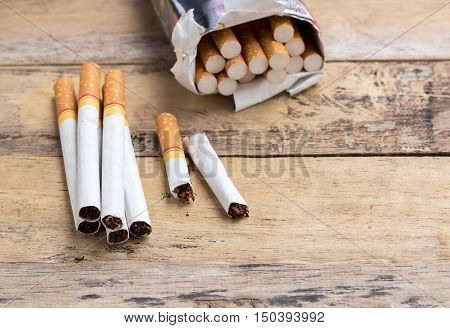 Tobacco cigarettes on a wooden table background. cigarette with health concept
