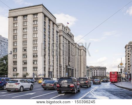 Moscow Russia -September 08 2016: The building the State Duma. Along the street Okhotny Ryad moving pedestrians and cars