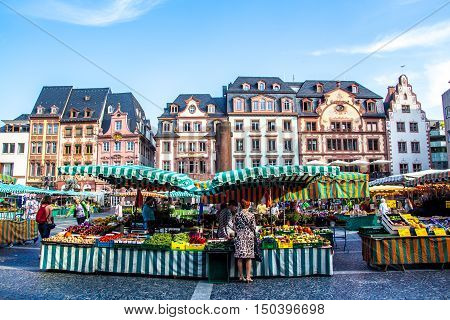 MAINZ Germany - September 02 2016 - people who roam the typical market in the old town of Mainz Germany