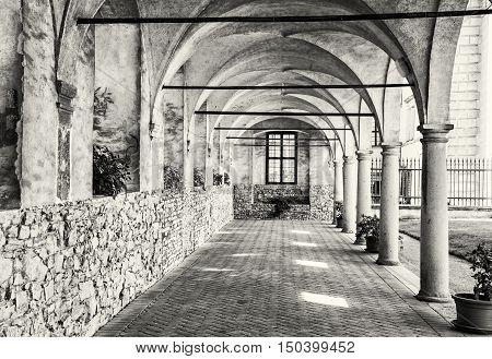 Medieval arcade corridor at Telc castle Czech republic. Black and white photo. Architectural scene. Unesco World Heritage Site. Travel destination. Beautiful place.