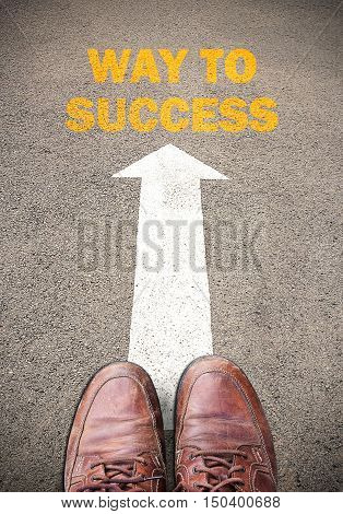 Old brown leather shoes and Text for WAY TO SUCCESS. Concept on the road surface marking with arrow for any design