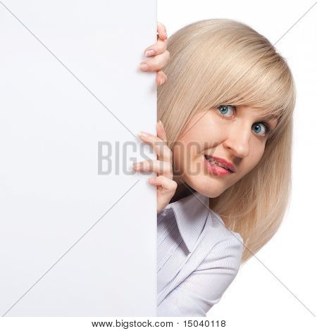 embarrassed young woman holding white empty paper isolated on white