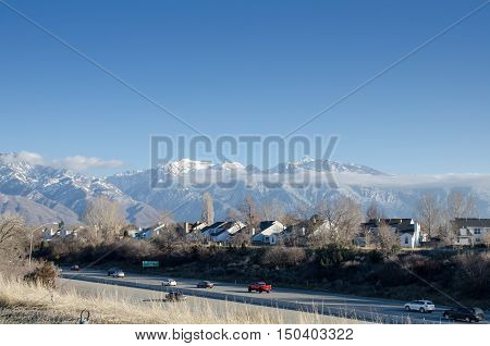 The Road And Snow Covered Mountains In Utah