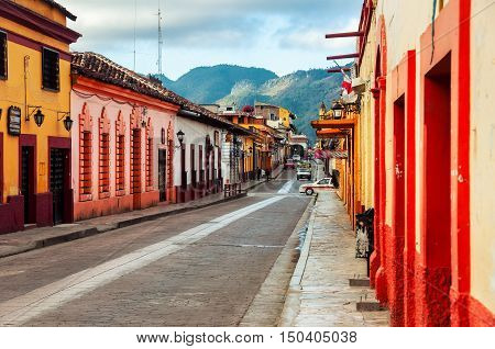 Streets in the cultural capital of Chiapas - San Cristobal de las Casas Mexico. The city center maintains its Spanish colonial layout and much of its architecture. Mountains at the background
