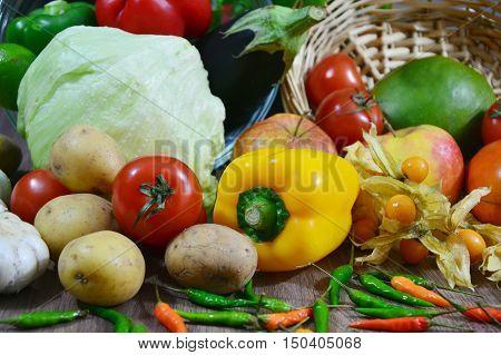 fresh Fruits and Vegetables infront of wooden basket