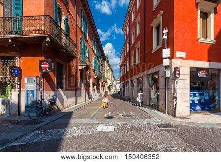 VERONA ITALY- September 08 2016: View on the cross road of streets of Via Roma and Via Carlo Cattaneo located on the center of Old City of Verona and walking local citizens.