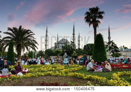 ISTANBUL TURKEY - JUNE 25 2015: People selebrating the end of Ramadan in the historical centre of Istanbul Turkey