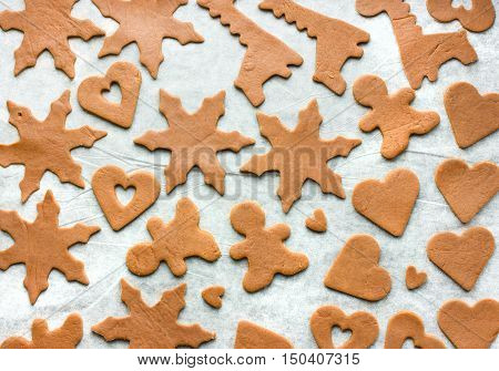 Varied festive homemade gingerbread cookies for Christmas and Valentine's Day preparation step