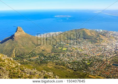 Aerial view of Lion's Head, the coast and Cape Town during a trek on the Table Mountain National Park, the promontory overlooking the city in Western Cape, South Africa.