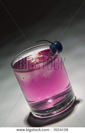 Drink With Blue Cherry And Ice