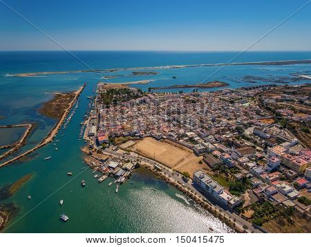 Aerial view of Fuzeta with coastline and docks, Algarve, Portugal,