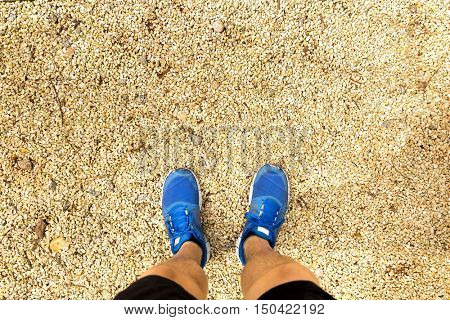 Point view of a runner man look down to his feet in the park