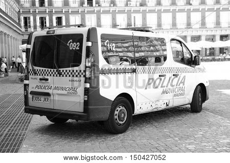MADRID, SPAIN - September 06, 2016: Police car on Plaza Mayor in Madrid. Black and white image