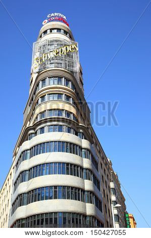 MADRID, SPAIN - September 06, 2016: The Capitol building with neon sign in Madrid
