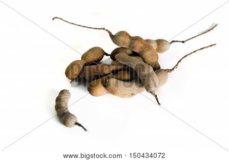 Pile Of Bitter Gourd Or Tamarind Isolated On White Background