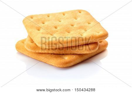 Three salted crackers isolated on white background