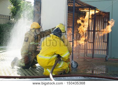 Firefighter Fighting For A Fire Attack, During  Training Exercise.