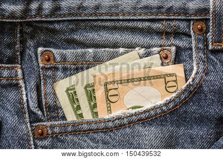 Money in old blue  jeans pocket. Close up