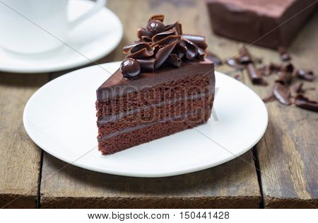 Chocolate Fudge Cake. Decorate With Curl Of Dark Chocolate. It Looks Soft And Delicious. You Can App
