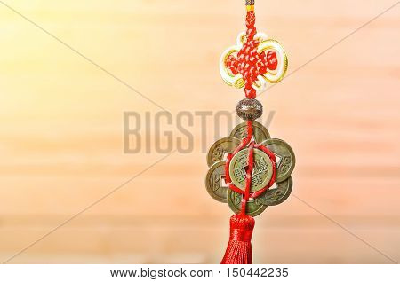 chinese coins of luck holding on wooden background.