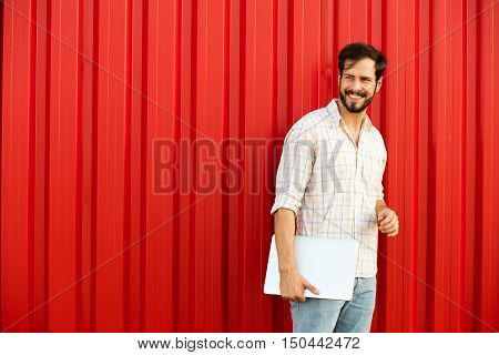 Man With Laptop On Red Background