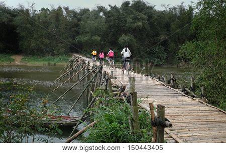 Children Ride Bicycle On Bamboo Bridge