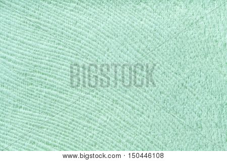 Light green background from a soft wool textile material closeup. Fabric with natural texture. Cloth backdrop.
