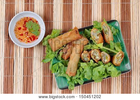 Deep fried spring roll  as four sheet wrap  fried vermicelli and sliced cabbage in roll bar to deep fried call