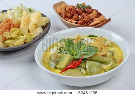 Close up  of  green fermented flour curry  with  mixed vegetables as red chili,eggplant,basil leaf,cabbage,correspondents topped coconut milk is popular food for Vegetable festival of Chinese  as
