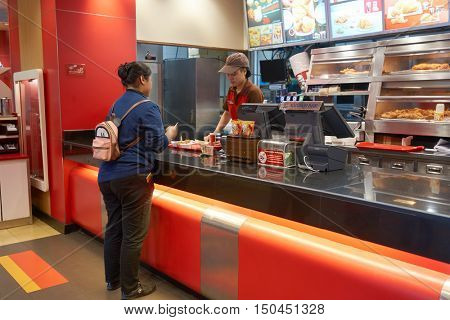 PATTAYA, THAILAND - FEBRUARY 22, 2016: Kentucky Fried Chicken in Pattaya. Kentucky Fried Chicken is a fast food restaurant chain that specializes in fried chicken.