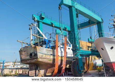 old ship repair in shipyard in the port