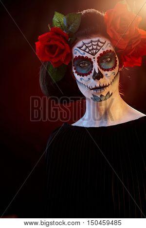 Woman in Halloween makeup - mexican Santa Muerte mask.