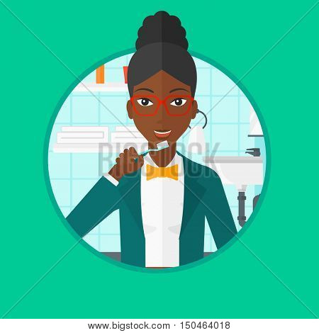 An african-american woman brushing her teeth with a toothbrush in bathroom. Smiling woman with toothbrush. Daily hygiene concept. Vector flat design illustration in the circle isolated on background.