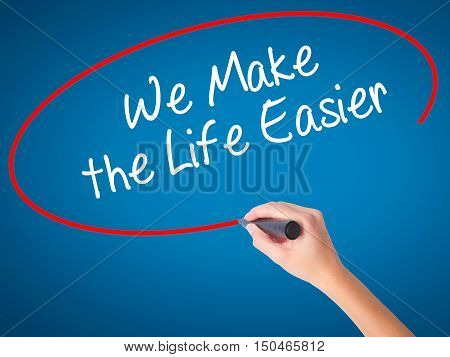 Women Hand Writing We Make The Life Easier With Black Marker On Visual Screen