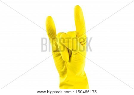 Woman's hand in yellow rubber gloves shows 'Horns Up' sighn. Fun house keaping concept