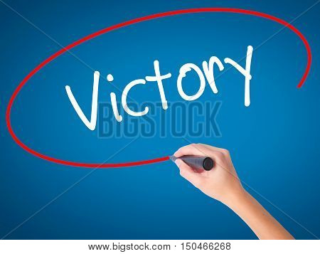 Women Hand Writing Victory  With Black Marker On Visual Screen