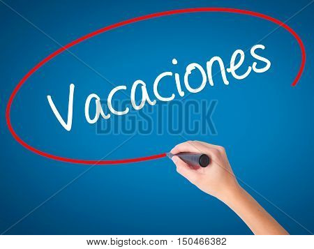Women Hand Writing Vacaciones (vacation In Spanish) With Black Marker On Visual Screen