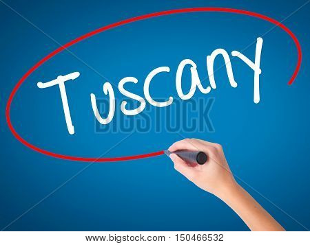 Women Hand Writing Tuscany With Black Marker On Visual Screen.