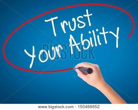 Women Hand Writing Trust Your Ability  With Black Marker On Visual Screen