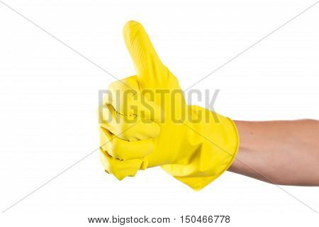 yellow rubber glove for cleaning on womans arm show thumbs up