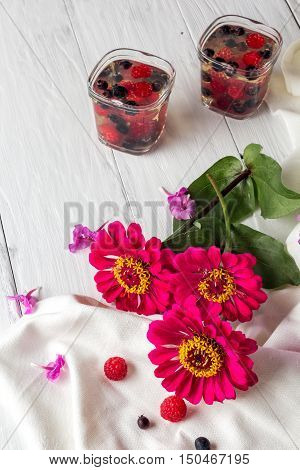red flowers and on background jelly berries