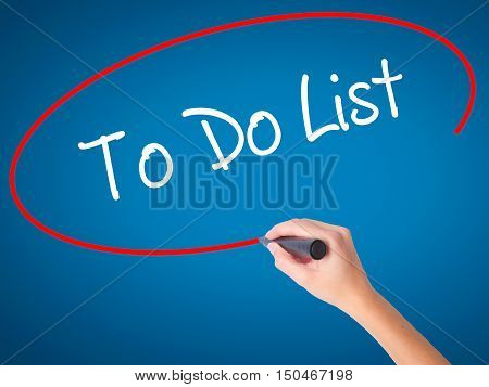 Women Hand Writing To Do List With Black Marker On Visual Screen