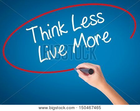 Women Hand Writing Think Less Live More With Black Marker On Visual Screen