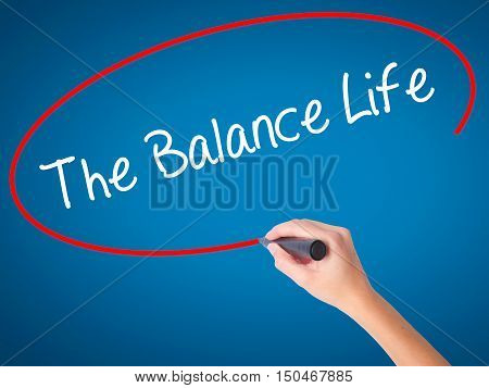 Women Hand Writing The Balance Life With Black Marker On Visual Screen