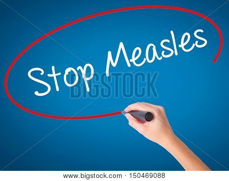 Women Hand Writing Stop Measles  With Black Marker On Visual Screen