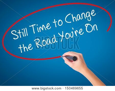 Women Hand Writing Still Time To Change The Road You're On With Black Marker On Visual Screen