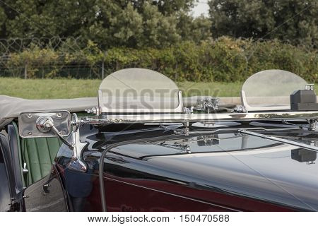 front of old convertible car perspective view with green background