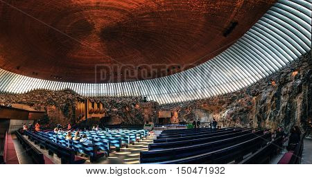 Helsinki Finland - March 17 2015: Interior of the Rock Church Temppeliaukio Church with pipe organ and copper ceiling dome in the center of the Helsinki City Finland.