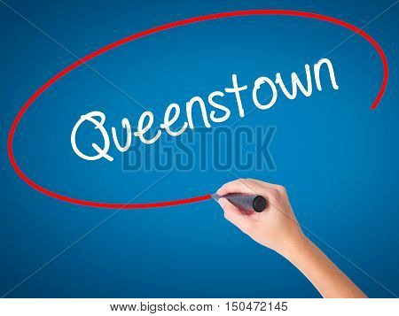 Women Hand Writing Queenstown  With Black Marker On Visual Screen
